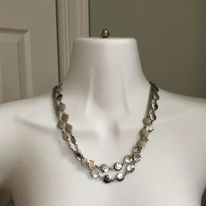 Long silver disc necklace.